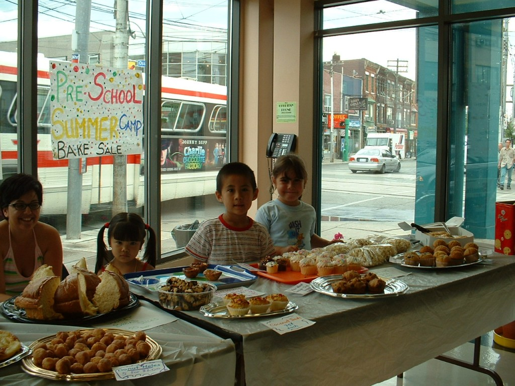 Kids having bake sale for pre-school summer camp